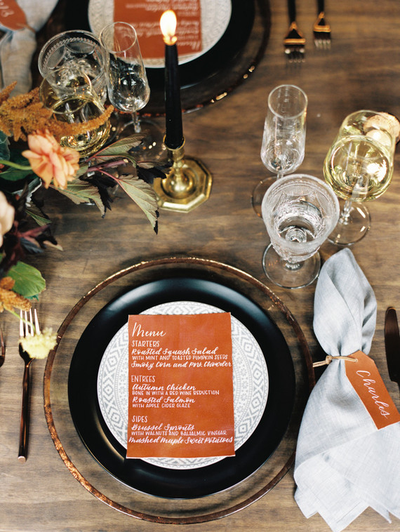 The tables were decorated with rust colored plateware and fall florals