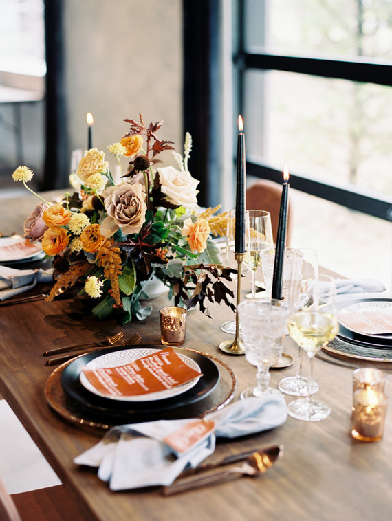 Rustic fall colors and florals decorate the clean lines of décor at this modern fall wedding themed photo shoot.