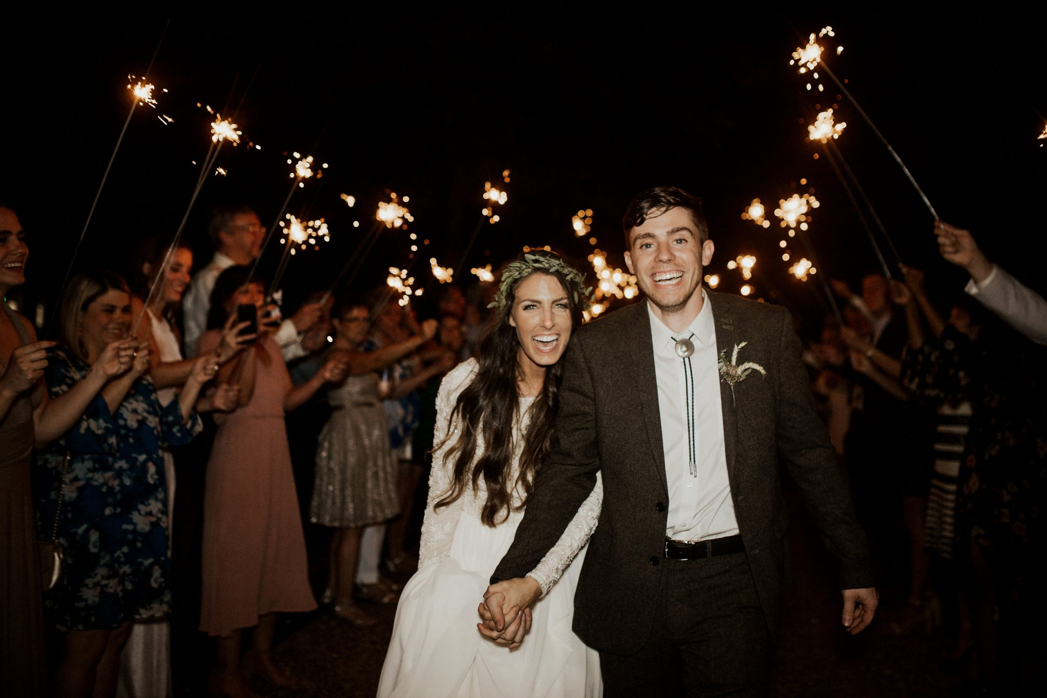 This rustic romance wedding reception ended with the guests all holding up sparklers for the newly married couple